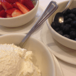 Whipped cream, blueberries and strawberries galore