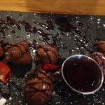 T&B beignets with berry sauce