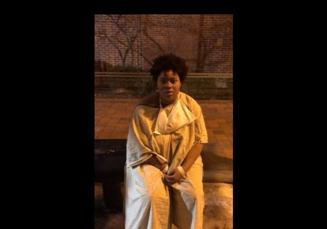A woman was left stranded on a Baltimore street at a bus stop wearing nothing but a hospital gown; Bystander posts a video to social media