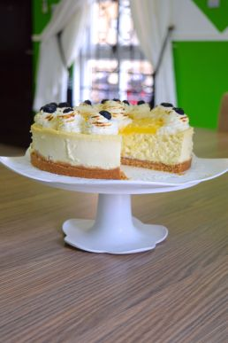 Lemon Cheese Cake cut out shot with cake stand