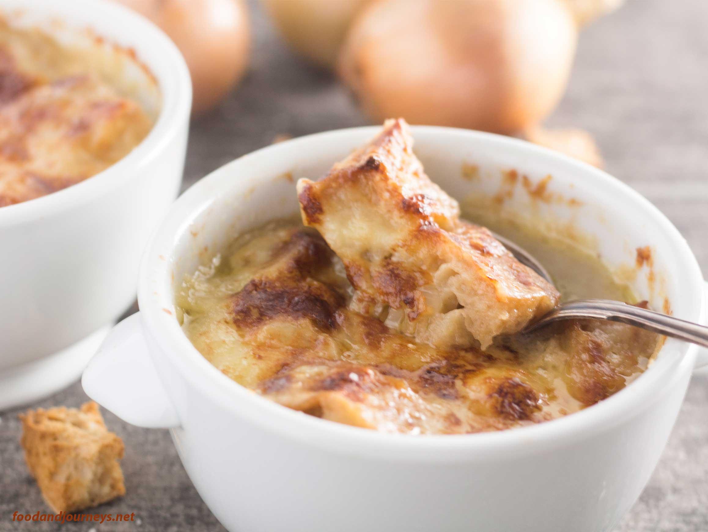 An image showing a spoonful of onion soup gratin|foodandjourneys.net