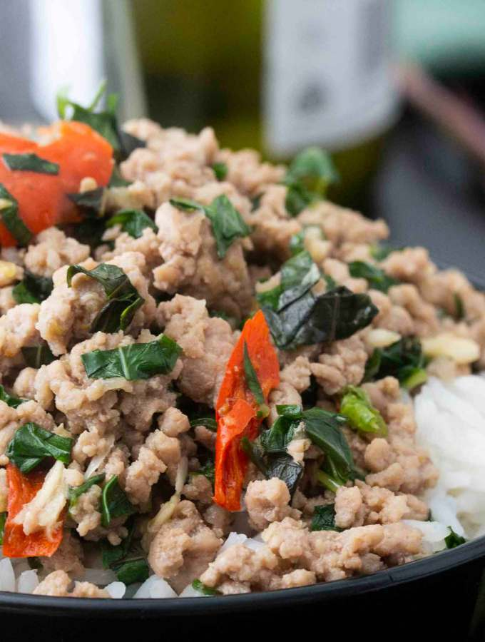 Closer shot of a serving of Thai Spicy Prok, highlighting the chili and thai basil on the pork.
