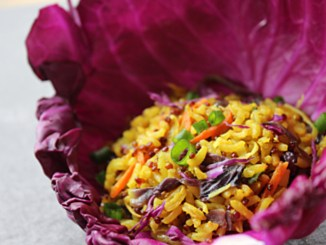 Curry-Spiced Grain dish served in a red cabbage leaf cup