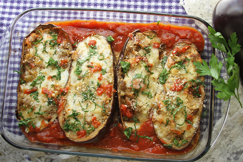 Eggplant Parmesan Bake in a casserole dish on a checkered dish towel