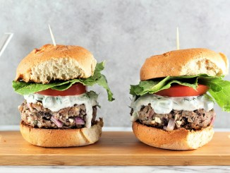 Two Lamb, Feta, and Black Bean Burgers with Greek Yogurt Tzatziki Sauce
