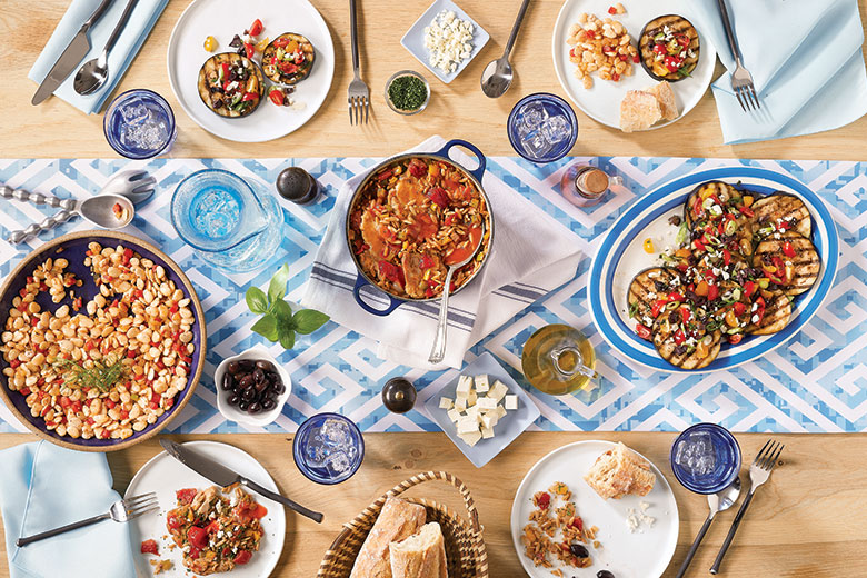 Greek dishes on display on a table