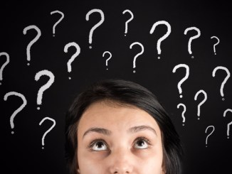 Woman's face surrounded by question marks
