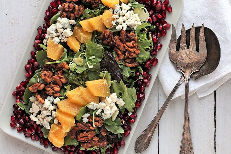 Spinach, Arugula & Pomegranate Salad with Cranberry Citrus Vinaigrette- Food & Nutrition Magazine - Stone Soup