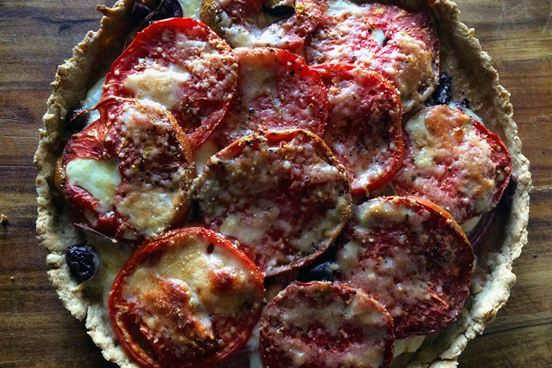 A fully baked Tomato Onion Tart with Olive Oil Crust shot from above.