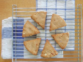 Six triple almond lemon scones on a cooling rack