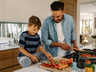 Father and son cooking in kitchen together