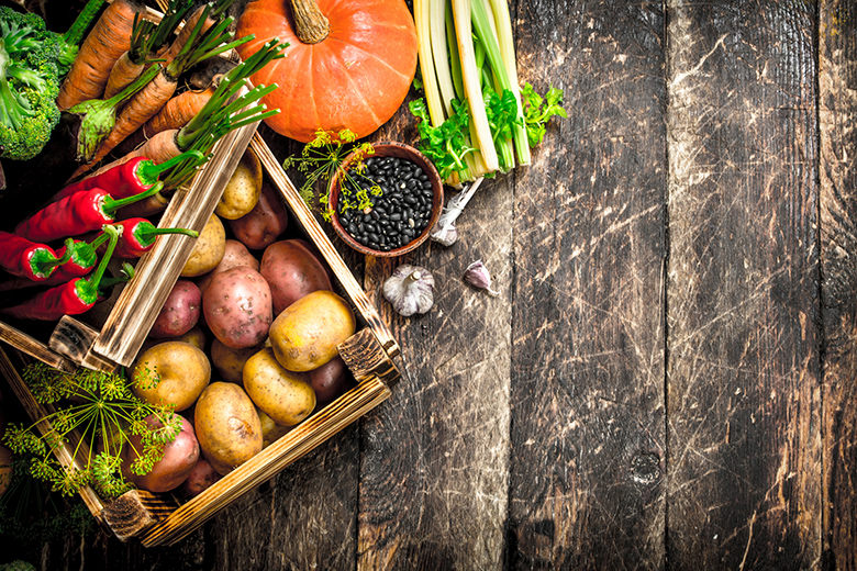 Organic food. Harvest of fresh vegetables in old boxes