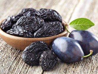 Plum with prunes on a wooden board