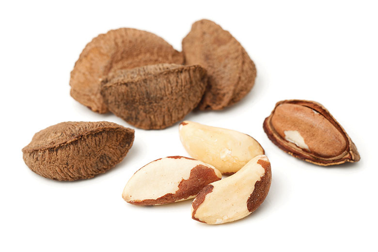A bunch of nuts on a white background.