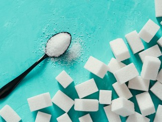 white sugar cubes on turquoise background