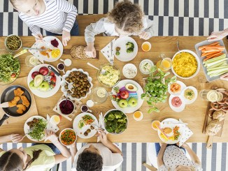 children eating healthy food during friend's birthday party