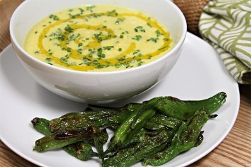 Chilled cucumber and yellow pepper soup with goat milk yogurt and pan-roasted shishito peppers
