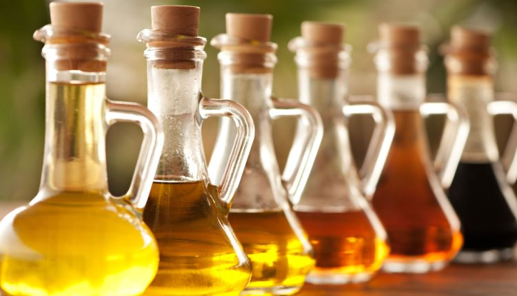 olive-oil-and-vinegar-in-bottles-on-the-table-176562631-5a6a7032c673350037faaec7