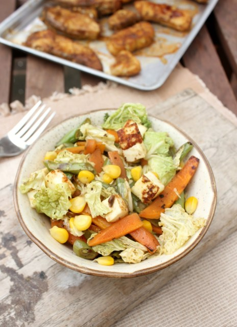 Asian stir fry of paneer, sweet corn and vegetables,grilled fish