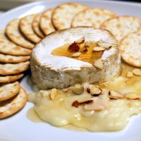 Baked Goat Brie with Honey and Almonds
