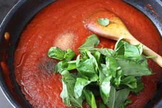 adding to tomato puree: salt, pepper& basilico