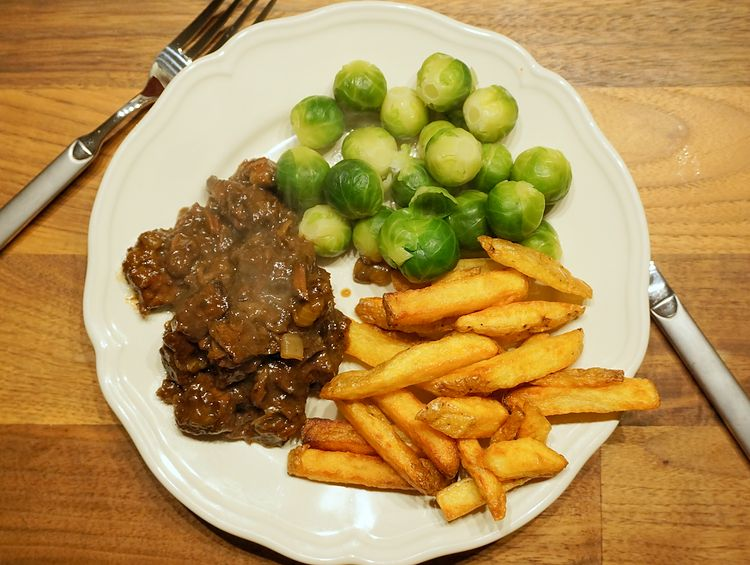 brussel sprouts with stewed meat and french fries