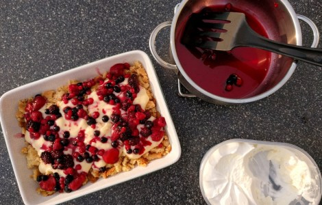 berry crumble with ice cream and fruit juice