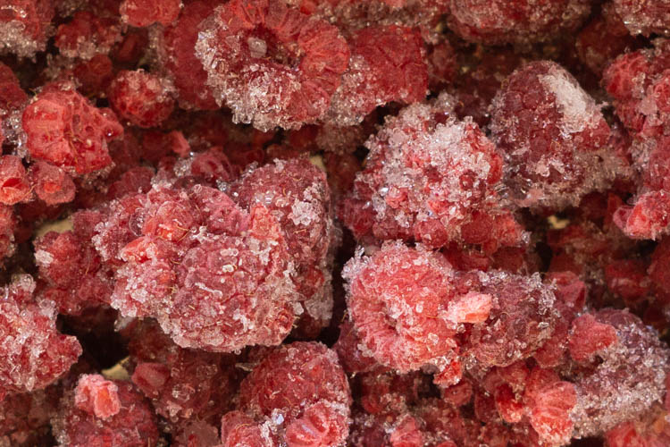 close up of ice crystals on frozen raspberries