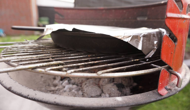 skillet with cookie on the barbecue