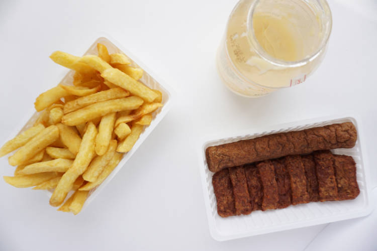 french fries from the 'snackbar' with mayonnaise and two typical dutch snacks