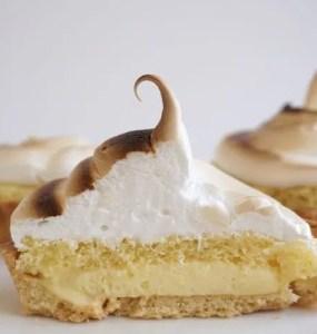 lemon meringue tart cut in two