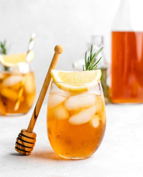 This non-alcoholic iced tea is sweetened with a rosemary honey simple syrup