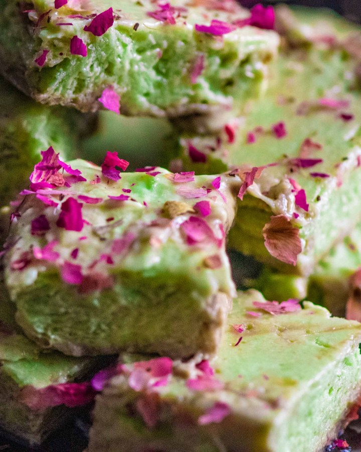 chunks of green creamy avocado ice cream sprinkled with rose petals