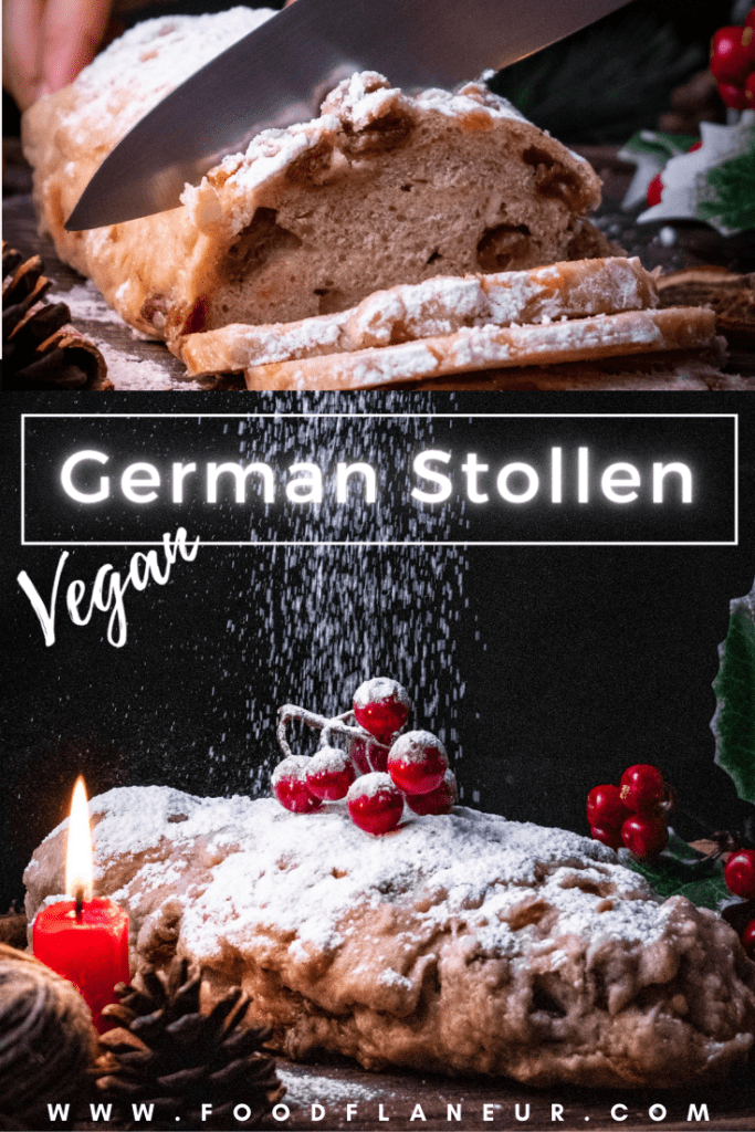 german christmas stollen being sliced next to candle and christmas decorations