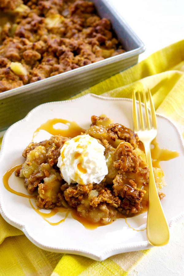 Apple Crisp with caramel and whipped cream.