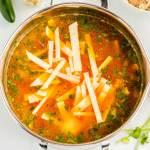 Stir in the spices, tortilla strips, and cilantro.