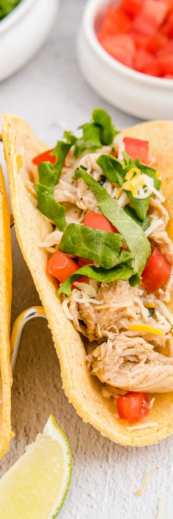 Quick and easy Crockpot Shredded Chicken Tacos for busy weeknight dinners.