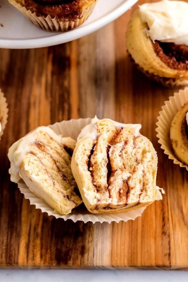 A cinnamon roll cupcake cut in half.