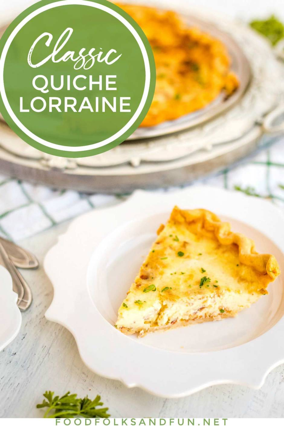 Quiche Lorraine slice on a white plate.