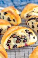 Close up picture of blueberry scones cooling on a wire rack.