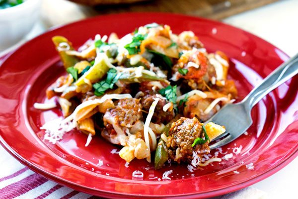 This Sausage and Peppers Pasta recipe is a quick & easy version of the slow-cooked Italian classic. It's vibrant, delicious, and great for busy weeknights!