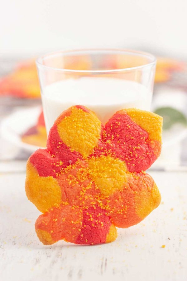 Fall cookies next to a glass of milk.