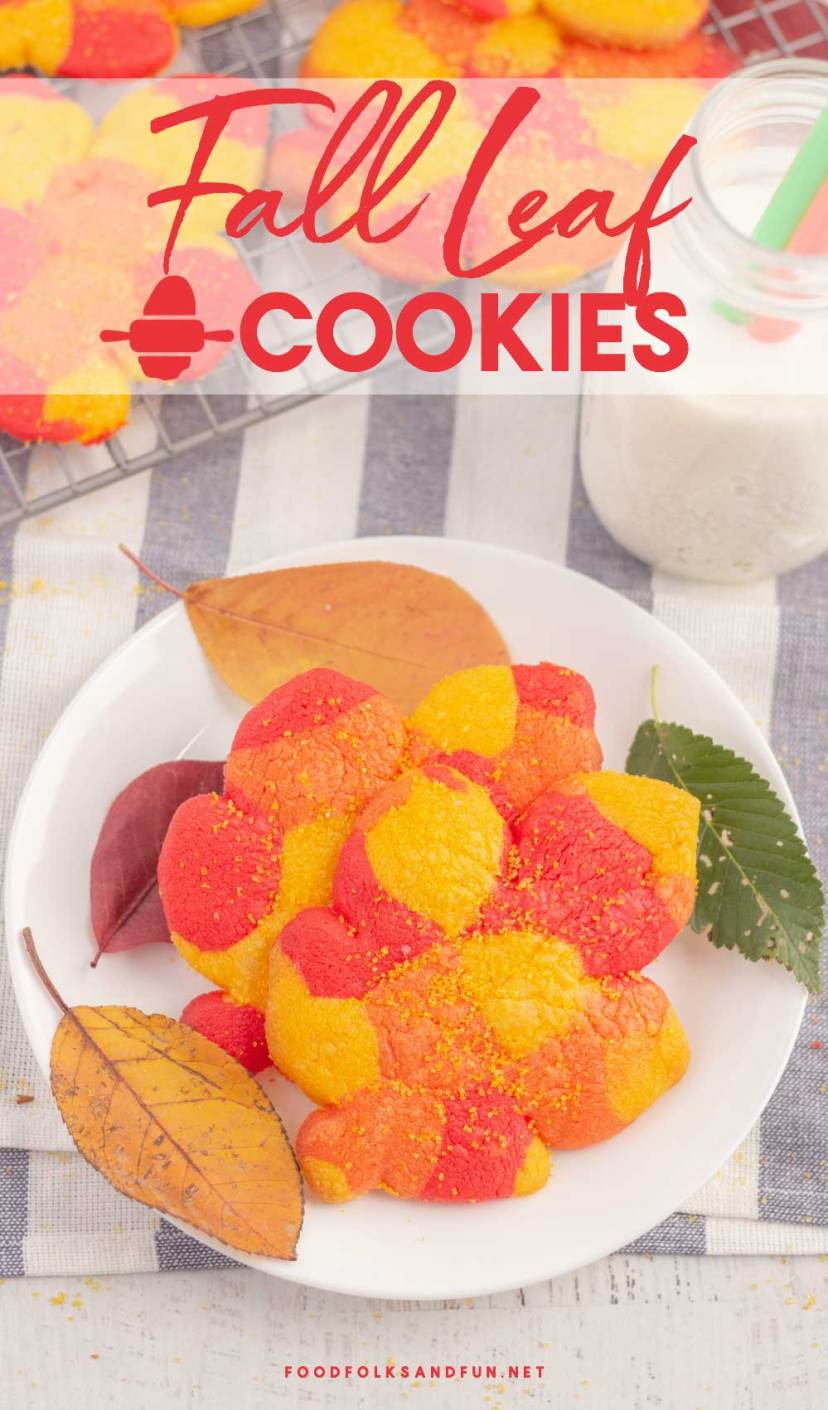 Fall leaf cookies dusted with sugar on a white plate.