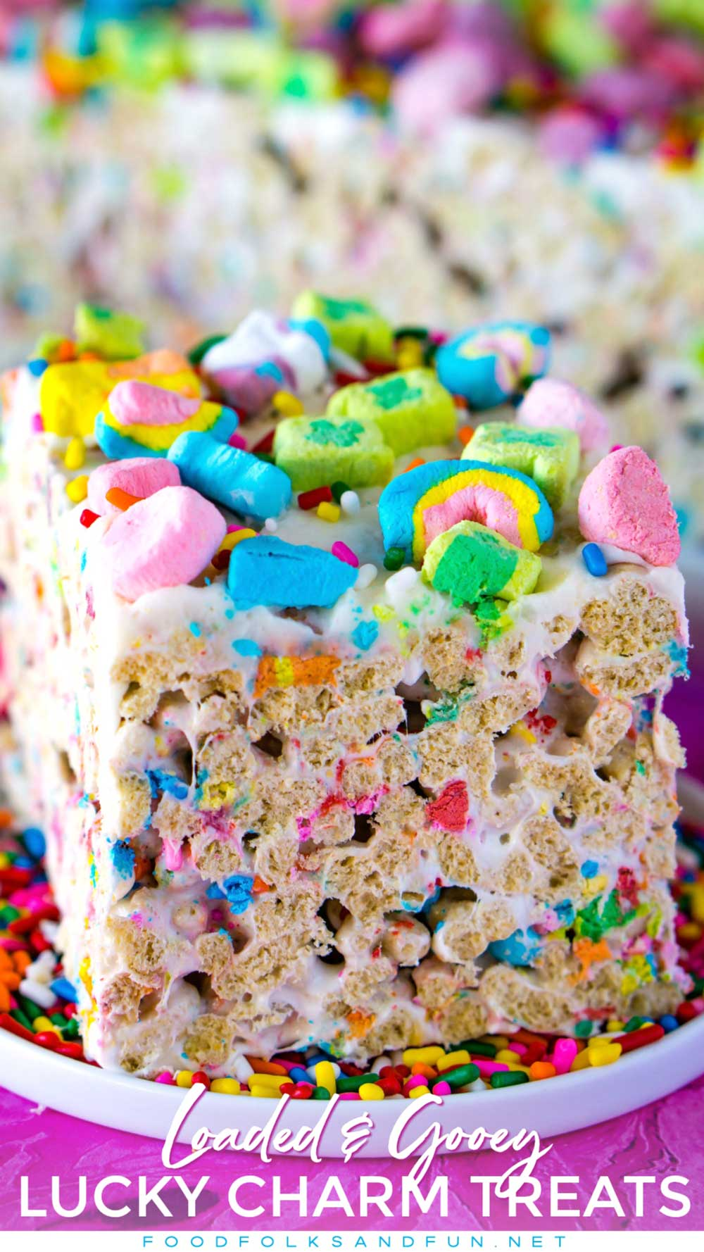 These Lucky Charms treats are gooey and loaded with marshmallows. They're topped with a thin layer of buttercream and even more marshmallows! via @foodfolksandfun