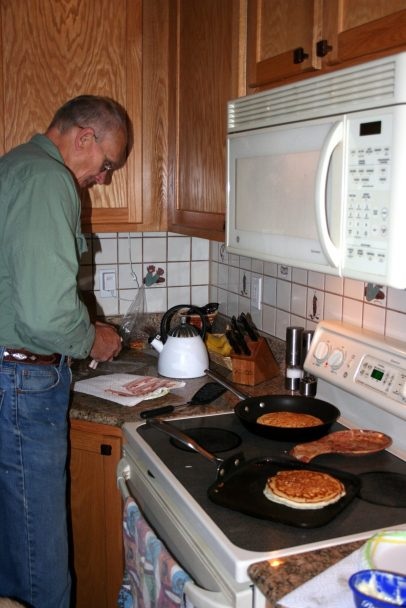 """My dad making his famous """"hotcakes""""."""