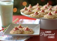 Peppermint Cookies on a plate and on a cake pedestal with a glass of milk.