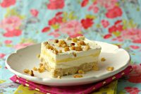Lemon Lush is a layered dessert with a shortbread crust, sweetened cream cheese, lemon pudding and whipped cream. This Lemon Lush recipe is made completely from scratch!