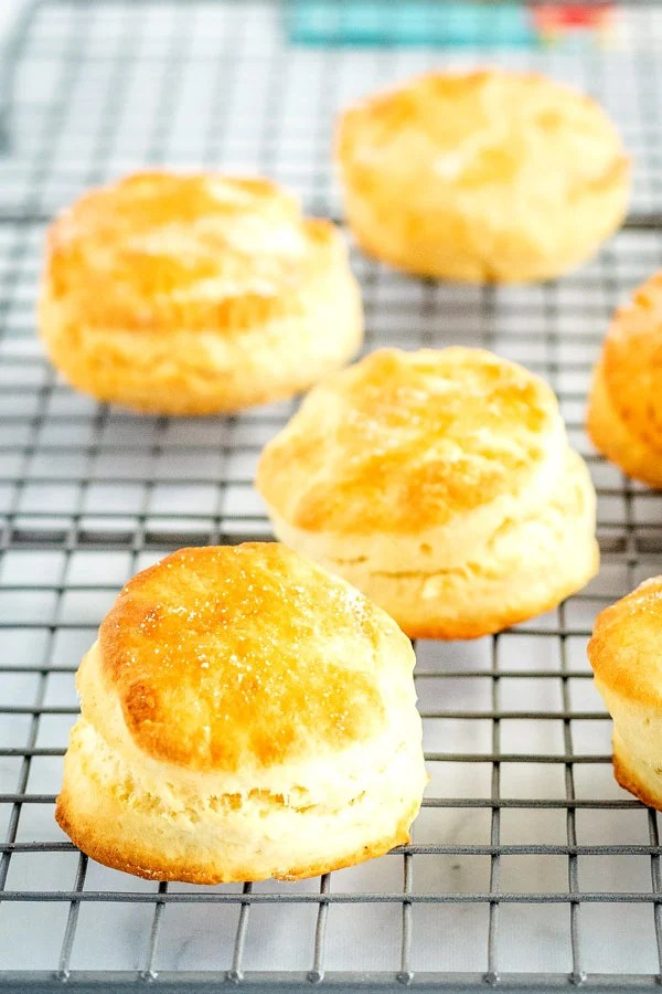 Golden biscuits on a wire cooling rack.