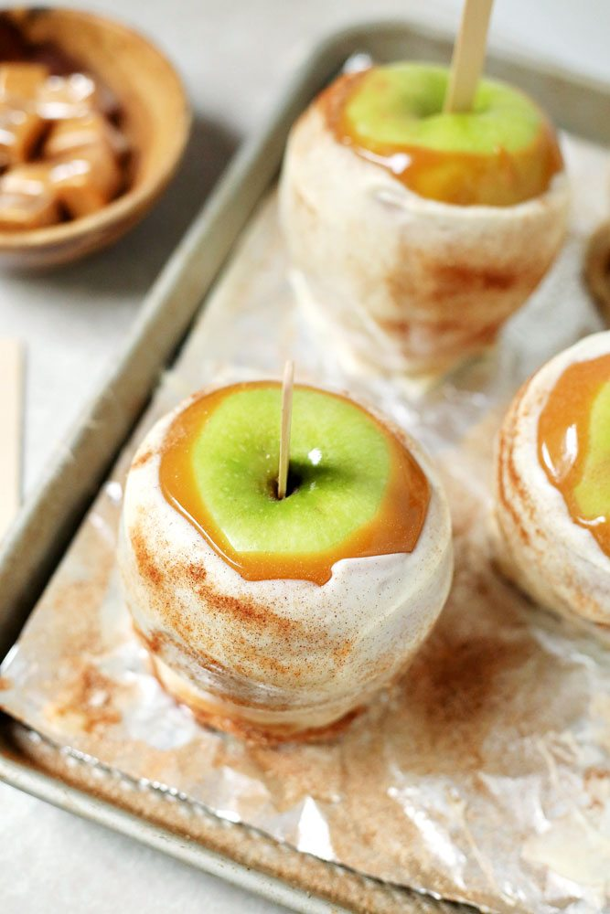 Apples dipped in caramel, white chocolate, and sprinkled with cinnamon sugar.