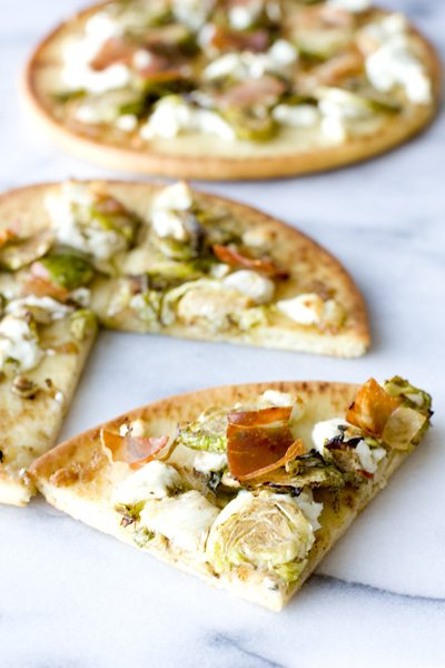 Brussels Sprouts Flatbread with a slice cut out of it.